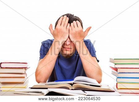 Tired Teenager Rub the Eyes on the School Desk Isolated on the White Background