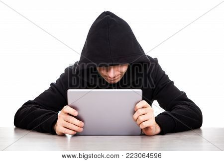 Hacker with a Tablet Computer on the White Background