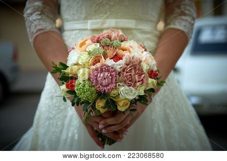 Close up beautiful weding bouquet in bride's hands