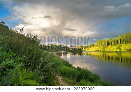 Admirable view of the stormy sky over the Volga river and its picturesque shores. Russian provincial town Rzhev.