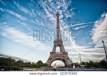 Eiffel Tower in Paris on beautiful autumn evening. Eifel tower is the symbol of Paris romantic and love poster
