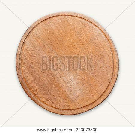 Round wooden cutting board isolated on white background. Closeup of textured rustic platter for cutting pizza, bread or meals serving, top view