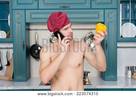 Guy In Chef Hat Smile With Yellow Pepper In Kitchen