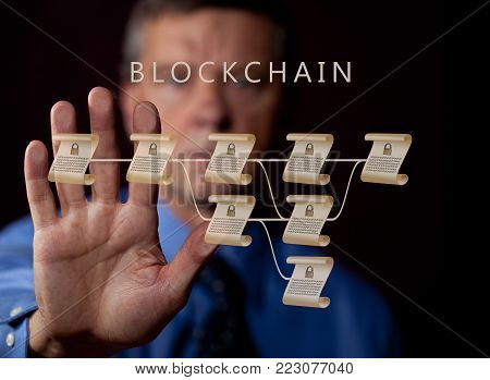 Blockchain schematic on glass panel with senior technology executive stopping or delaying the introduction of blockchain