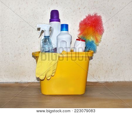 A bucket with cleaners. Cleaning of the apartment.