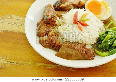 braised pork trotters and boiled egg with rice on plate