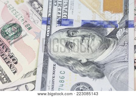 Background of one hundred dollar bills. Macro shot of one hundred dollars bill