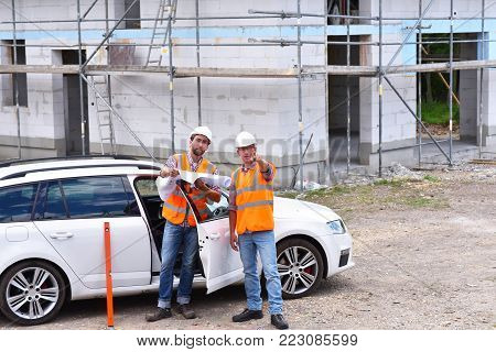 Teamwork On The Construction Site - Site Manager And Architect On Site During The Construction Of A