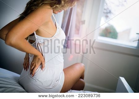 Beautiful cute pregnant woman having body aches
