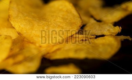 Rotating Potato Chips Close Up, Macro View Food Background. Close-up Of Yellow Delicious Chips Rando