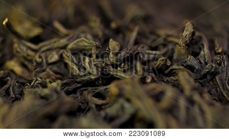Background Texture Of Sencha Green Tea - Fresh, Sweet, Delicate Tea. Black Tea Close Up Background.