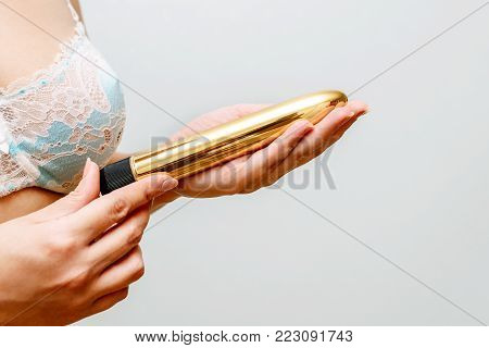 the girl's photo with the vibrator in hands