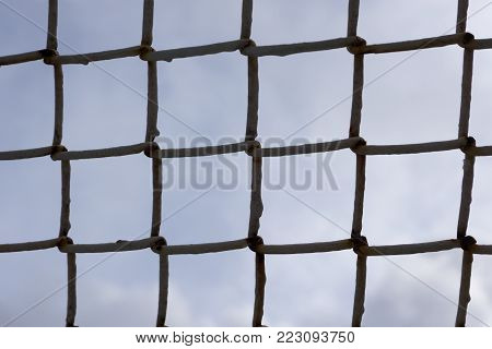 clean background iron mesh on a blue sky