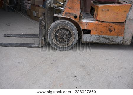 Heavy Forklift loader for warehouse works outdoors with risen forks