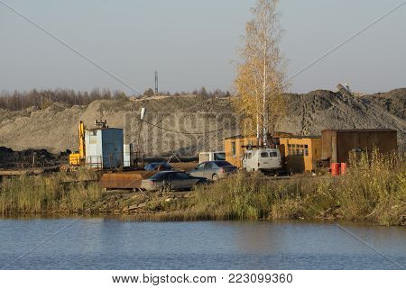The working trailer of the shed for the workers. The construction of high-speed ring road around Heavy machinery for excavation works in the civil industrial construction