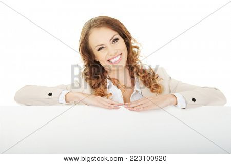 Smiling business woman with empty banner.