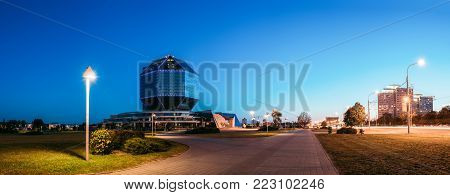 Minsk, Belarus - August 28, 2016: View Of Deserted Pedestrian Zone To National Library Building In Evening LED Illumination Blue Sky Background. Famous Hi-Tech Landmark, Cultural Informational Science Center.