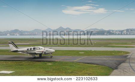 Beechcraft Baron B55 taxiing on the runway in Rio de Janeiro, Brazil