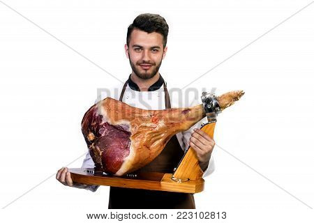 the cook is holding a pig's smoked leg, isolated on white background