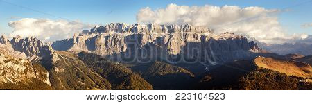 Evening view of Sella gruppe or gruppo di Sella with clouds and Selva Val Gardena or Wolkenstein, South Tirol, Dolomites mountains, Italy
