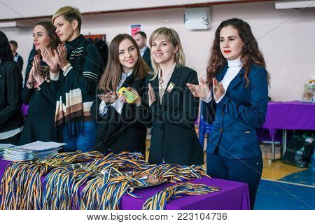 Kamenskoye, Ukraine - March 9, 2017: Championship of the city of Kamenskoye in cheerleading among solos, duets and teams, Judges are preparing for the award ceremony