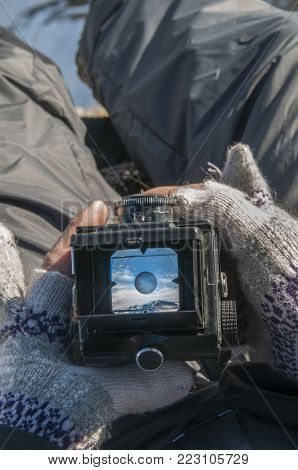 Look At The Mountain Scenery Through The Viewfinder Of An Old Camera