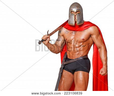 Image of tense shirtless warrior in helmet and with sword