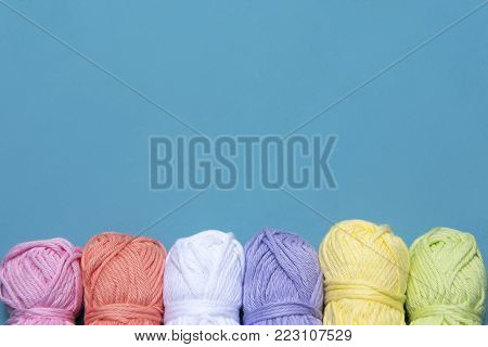 Arts and crafts background image of colourful yarn, taken with copy space