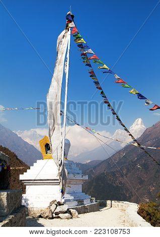 White stupa and prayer flags near Namche Bazar, mount Everest, Lhotse and Ama Dablam, way to Everest base camp, Khumbu valley, Solukhumbu, Sagarmatha national park, Nepal Himalayas