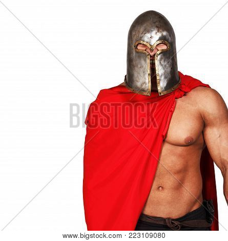 Portrait of shirtless warrior in helmet and red mantle and with grin on his face