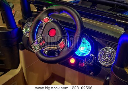 BANGKOK, THAILAND - JANUARY 19, 2018: Steering wheel and indiglo speedometer gauge of a generic branded child'res vehicle.