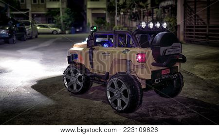 BANGKOK, THAILAND - JANUARY 19, 2018: Rugged generic branded electric powered children's offroad vehicle with lights on.