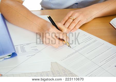 Businesswoman signature document, working at her office