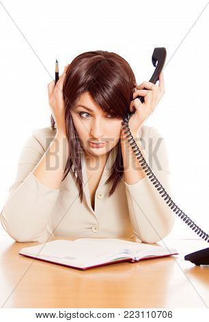 Girl Secretary works in the office, a lot of talking on the phone. hard work. unpleasant conversations