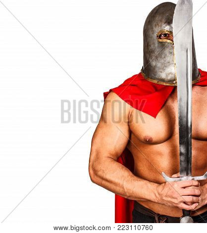 Image of calm warrior who is holding his sword in front of his face