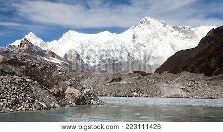 View of mount Cho Oyu and lake on Ngozumba glacier near Gokyo village - Gokyo trek, trek to Cho Oyu base camp and three passes trek, Gokyo valley, Sagarmatha national park, Khumbu valley, Nepal