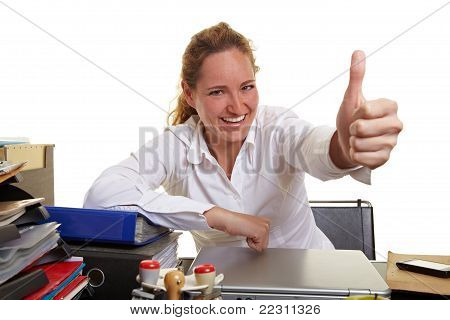 Business Woman At Desk Holding Thumbs Up