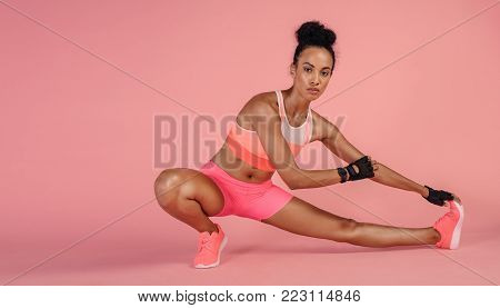 Tough Woman Exercising With Resistance Band