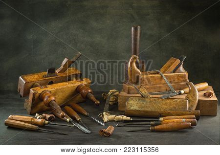 Still life with carpentry tools, bench planes of the joiner, wood carving chisel