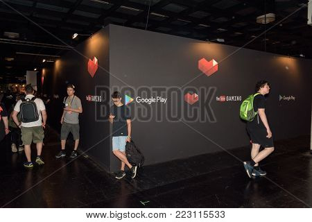 Cologne, Germany - August 24, 2017: Boys are standing at the corner of the booth of Youtube and Google at Gamescome 2017. Gamescom is a trade fair for video games held annually in Cologne.