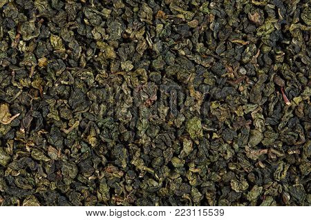 Tieguanyin Tea leaves, Chineese Oolong tea. Texture. High resolution photo