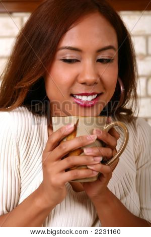 Model Smelling Hot Coffee
