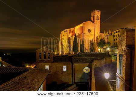 View on the Basilica of St. Dominic at night. Siena. Tuscany Italy