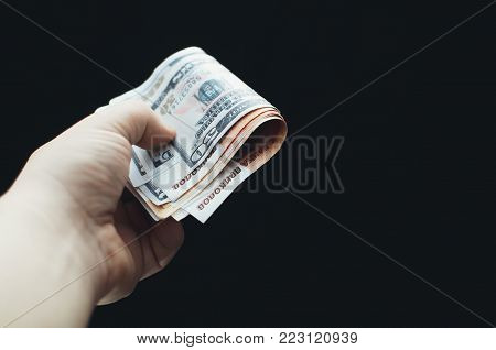 On A Black Background In Hand Money
