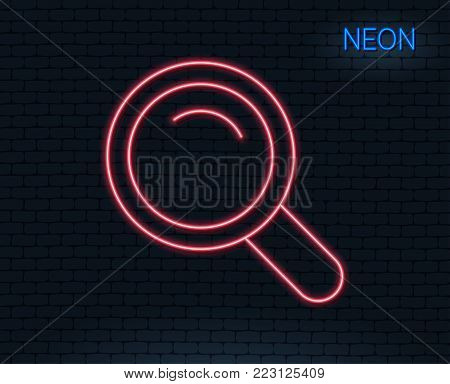 Neon light. Search line icon. Magnifying glass sign. Enlarge tool symbol. Glowing graphic design. Brick wall. Vector