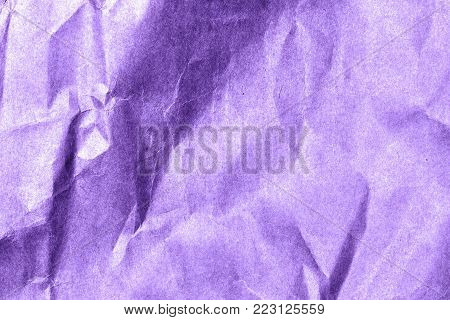 Paper texture with a roughness in colors of the year 2018, ultra violet pantone