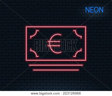Neon light. Cash money line icon. Banking currency sign. Euro or EUR symbol. Glowing graphic design. Brick wall. Vector