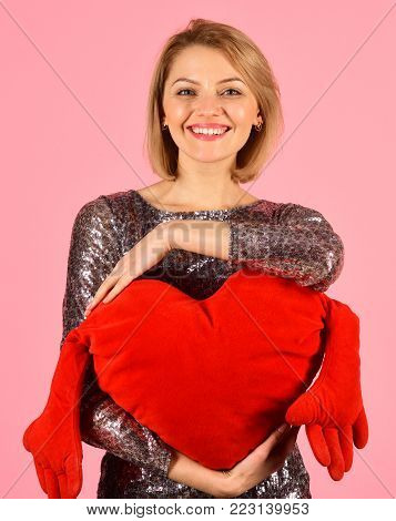 Lady With Blond Hair Puts Her Arms Around Toy Heart.