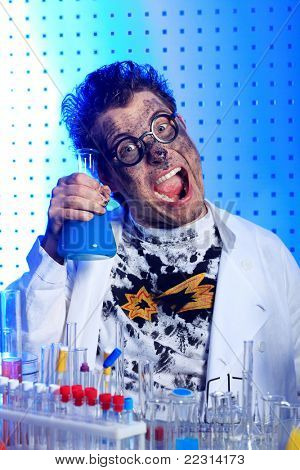 Medical theme: funny crazy scientist is working in a laboratory.