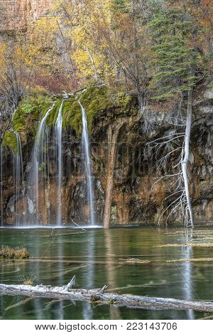 Hanging Lake is a geologic wonder and is popular with travelers for its awe-inspiring beauty and gentle Colorado waterfals. Suspended on the edge of Glenwood Canyon's cliffs, the clear turquoise lake and the waterfalls that spill into it are a breathtakin